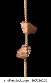 Climbing rope. Hands holding a rope, strength and determination concept.