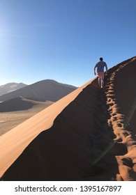 Climbing sand dunes in Sossusvlei, Namibia and exploring the dead trees in Deadvlei