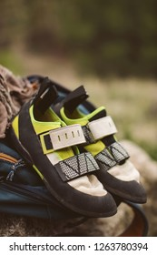 Climbing shoes placed on top of a backpack.