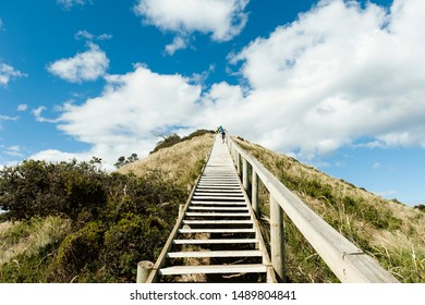 Climbing the staircase up the long incline up a steep hill