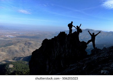 climbing team and the cliffs