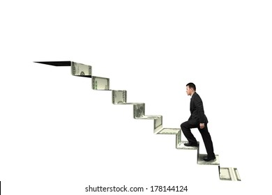 Climbing to top of money stairs isolated in white background