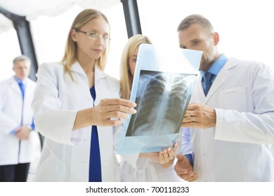 Clinic, people, healthcare and medicine concept - group of medics with chest x-ray scan at hospital