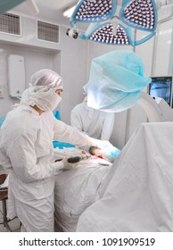 Clinical Hospital. operation. Portrait of a surgeon at work. Complex operation on the arm and leg. limb injury