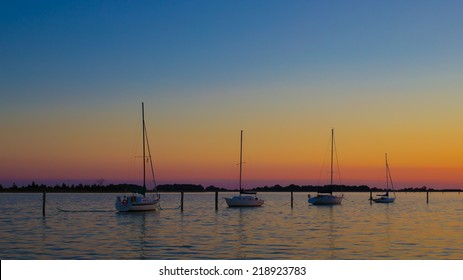 CLINTON, CONNECTICUT September 18th: Sailboats at sunset in a marina at sunset. on Sept. 18, 2014 in Clinton, CT.