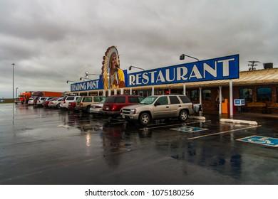 CLINTON, OKLAHOMA - JUNE 29, 2007: Cherokee trading post and restaurant on a rainy day along the interstate 40 in Clinton, Oklahoma.