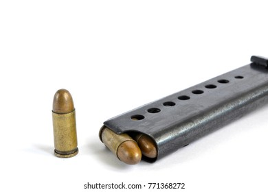 Clip and ammunition on the white background.