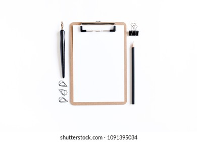 Clip board with white blank paper, black paper clips, calligraphic pen, pencil on a white background