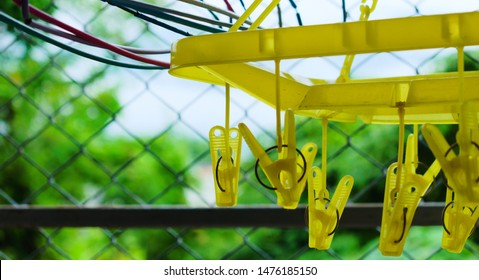 Clip square Clothes Hanger and Clothes hangers at the outdoor area in room.