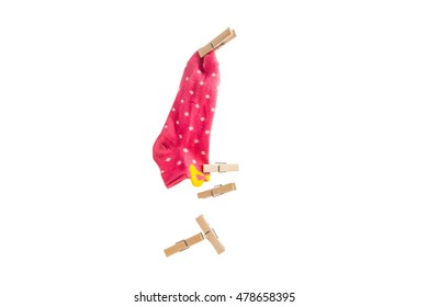 Clip wood  hold a pink sock on isolated.