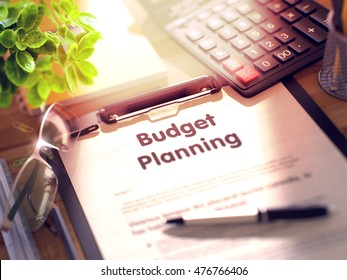 Clipboard with Business Concept - Budget Planning on Office Desk and Other Office Supplies Around. 3d Rendering. Blurred Toned Illustration.