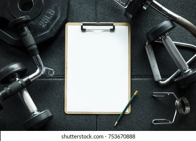 Clipboard for check list with free copy space in Gym with fitness equipment background