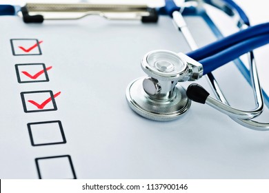 Clipboard with checklist and stethoscope.