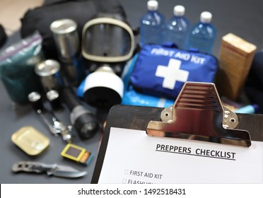 Clipboard checklist.Preppers are know for preparing for natural disasters,economic collapse,civil unrest or any doomsday scenario Such items would include food,water,lighting,shelter,and first aid kit
