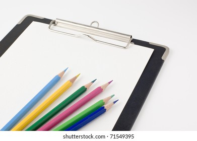 clipboard and colored pencils.