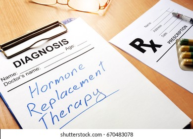 Clipboard with medical form and sign Hormone Replacement Therapy.