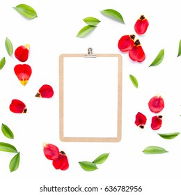 Clipboard mock up with beautiful red tulips isolated on white background. Flat lay, top view. Minimalistic office desk. Beauty blog concept.