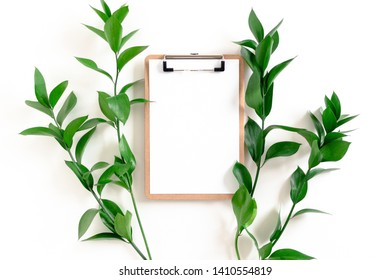 Clipboard mockup with ruscus branches on white background