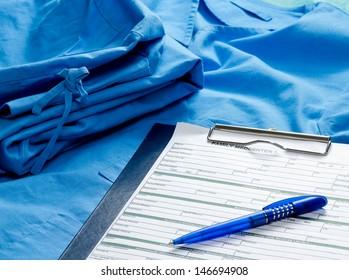 A clipboard on a medical uniform, closeup