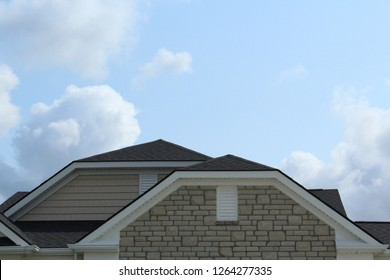 Clipped gable roof, AKA jerkinhead roof. Flattened version of standard gable roof. Instead of rising to point, gable is clipped off. Visual intrigue. Reduces wind force. Craftsman. Bungalow. Dutch hip