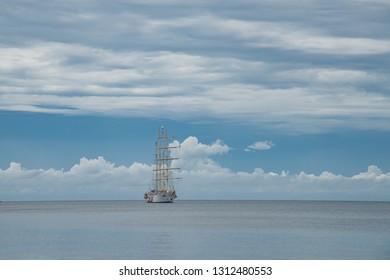 Clipper cruise ship anchored at horizon