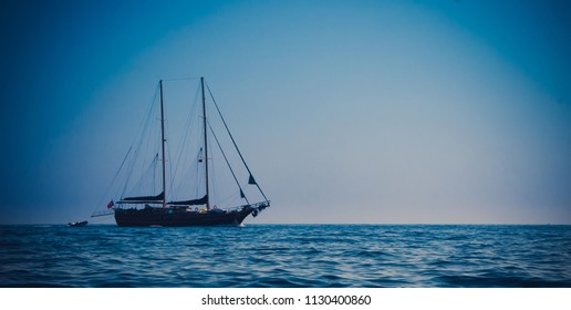 Clipper navigating through the seas, vignette background
