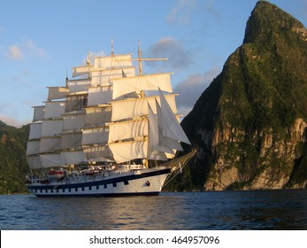 Clipper ship sailing with full sail beneath the Pitons, St Lucia