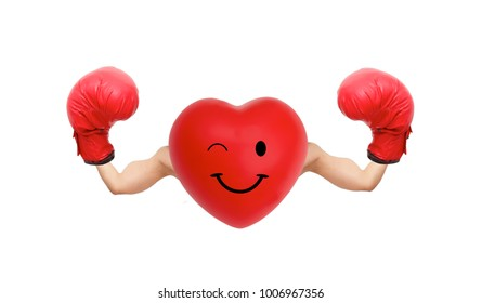 Clipping path. The Photo of heart with muscular boxing arms. The concept of a strong heart