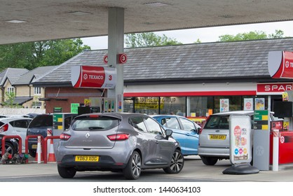 Clitheroe, Lancashire/UK - June 18th 2019: Texaco petrol station with Spar shop and cars at petrol pumps on forecourt