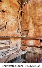 The cloak room in the old schoolhouse in the ghost town of Govan, Washington shows the cracks in the lathe and plaster interior.