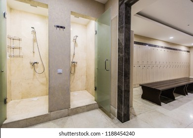 Cloakroom in the hotel or gym, wooden wardrobes, bench and shower rooms