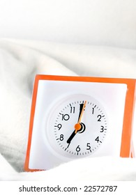 Clock in bed in the morning