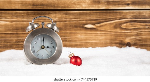 clock with christmas ball for time change in winter