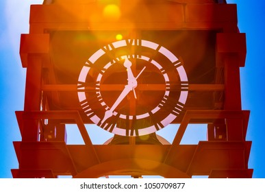 Clock close to noon with sun flares