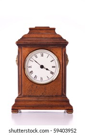 A clock commonly placed on the mantlepiece in the living room