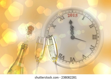 Clock counting to midnight against sparkling wine