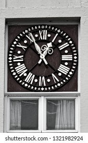 Clock dial on a historic house downtown Bruges, Belgium.