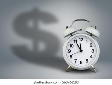 Clock with dollar shadow, time is money concept