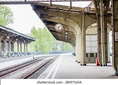 Clock at empty platform at Vitebsk railway station in St.-Petersburg, Russia.