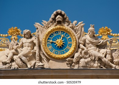 Clock at the entrance of Versailles palace in France