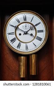 A clock face of an antique clock