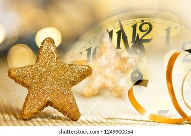 Clock face before midnight on the New year eve