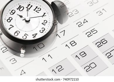 Clock face and calendar close-up.