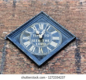 "Clock face on a church tower ""It's Time To Seek The Lord"" Saint Nicholas church Nottingham UK."