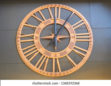 Clock face on the wall. Twelve o'clock and five minute by retro numbers timer design. Classic ancient antique watch isolated. Traditional roman old graphic time object design.