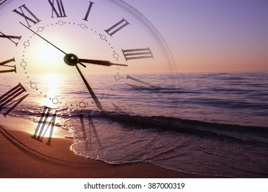 Clock face in view of beautiful sunrise on the beach