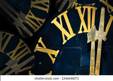 The clock with gilded Roman numerals shows twelve hours. The midnight on tower clock.