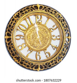 Clock with gold decoration on a white isolated background shows the approach of the New Year