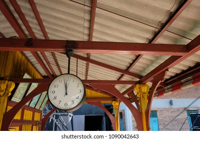 The clock hang on the roof beam of train station.It show the time of trains arrival and departure.