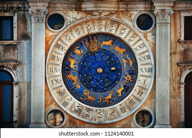 Clock with horoscope in historical buildings at Piazza San Marco in Venice, Italy.